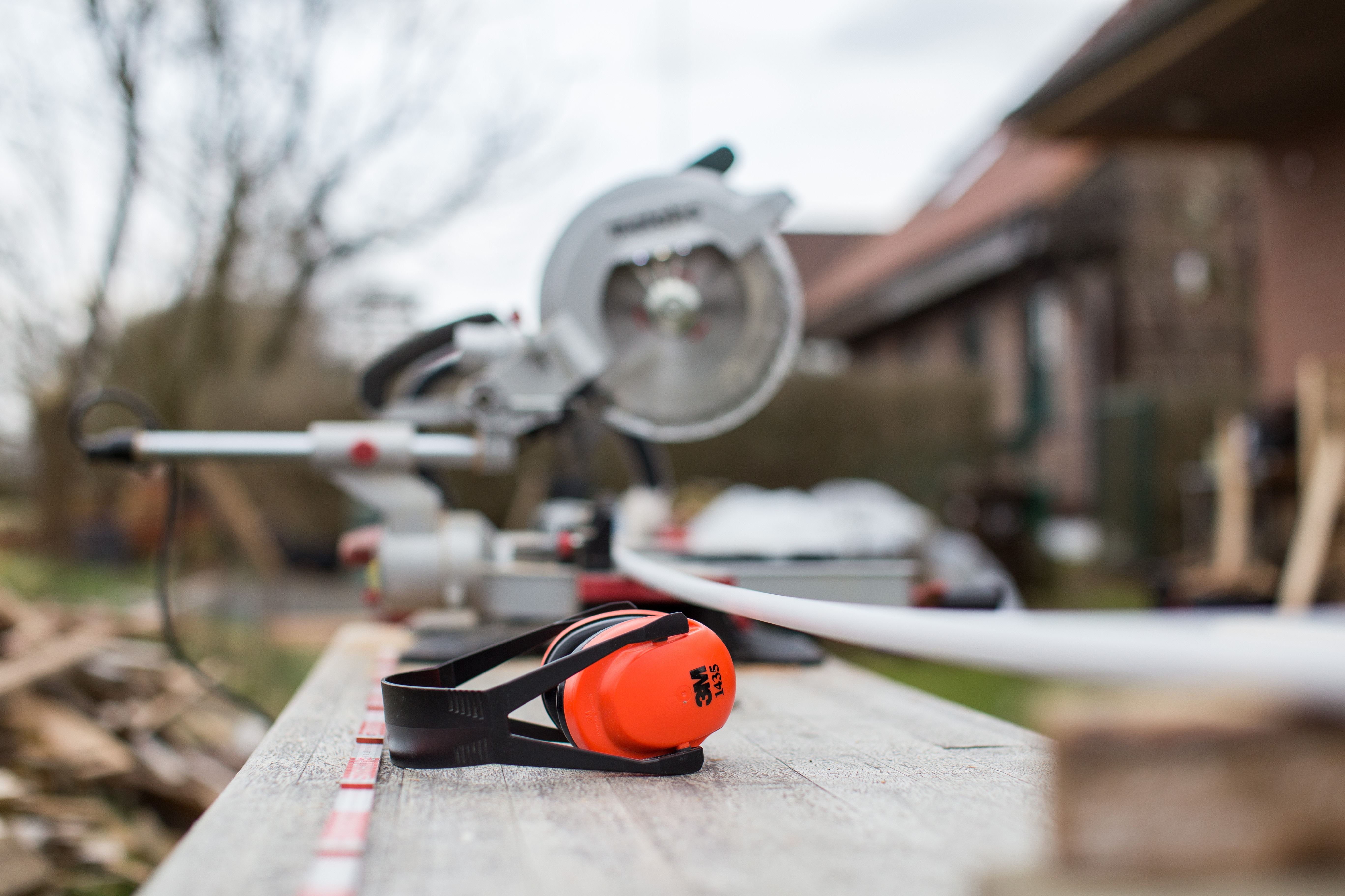 Protective headphones and chainsaw
