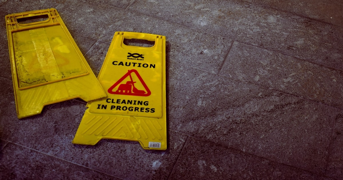 Broken cleaning in progress sign