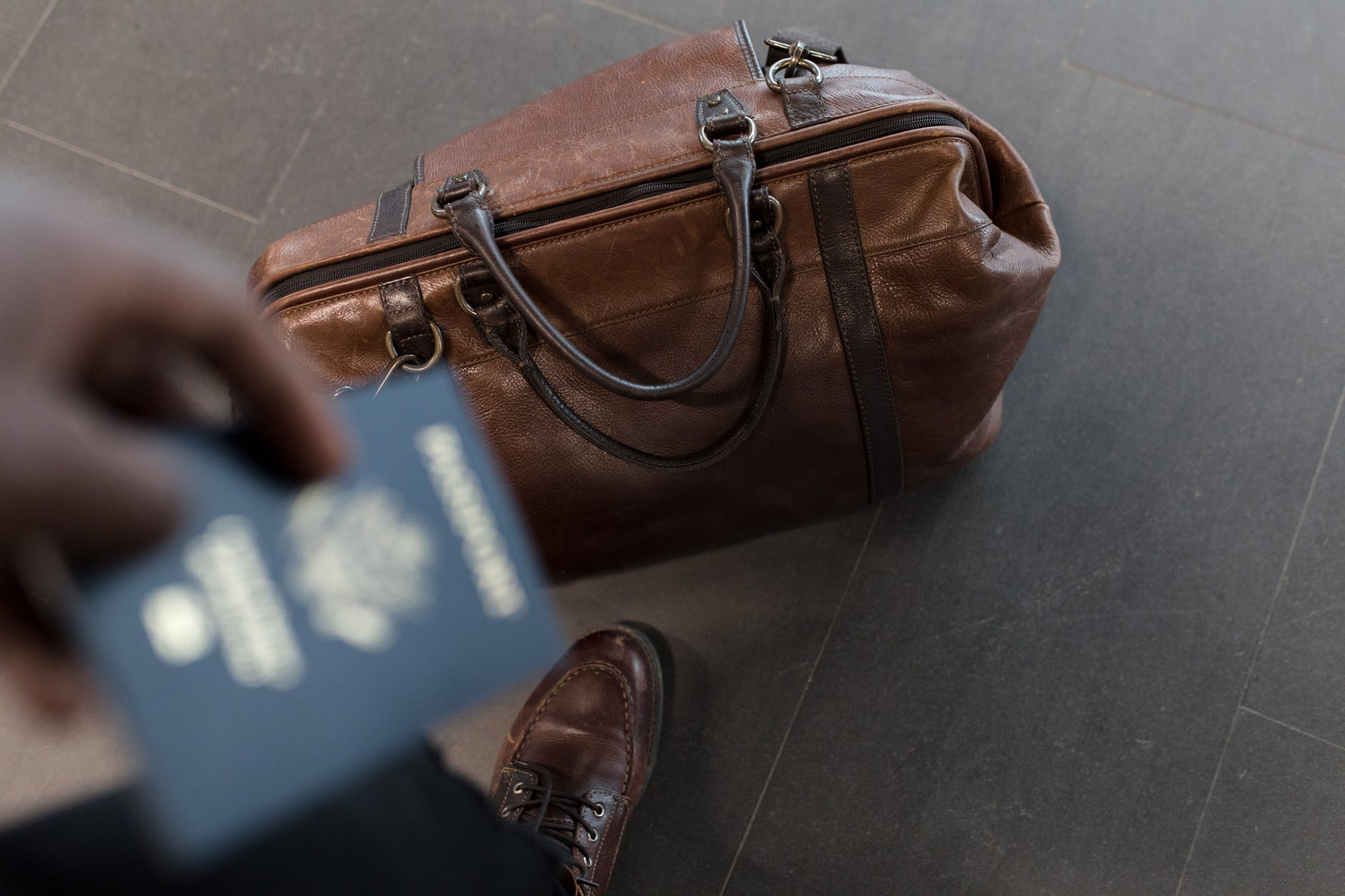Passenger with bag holding a passport