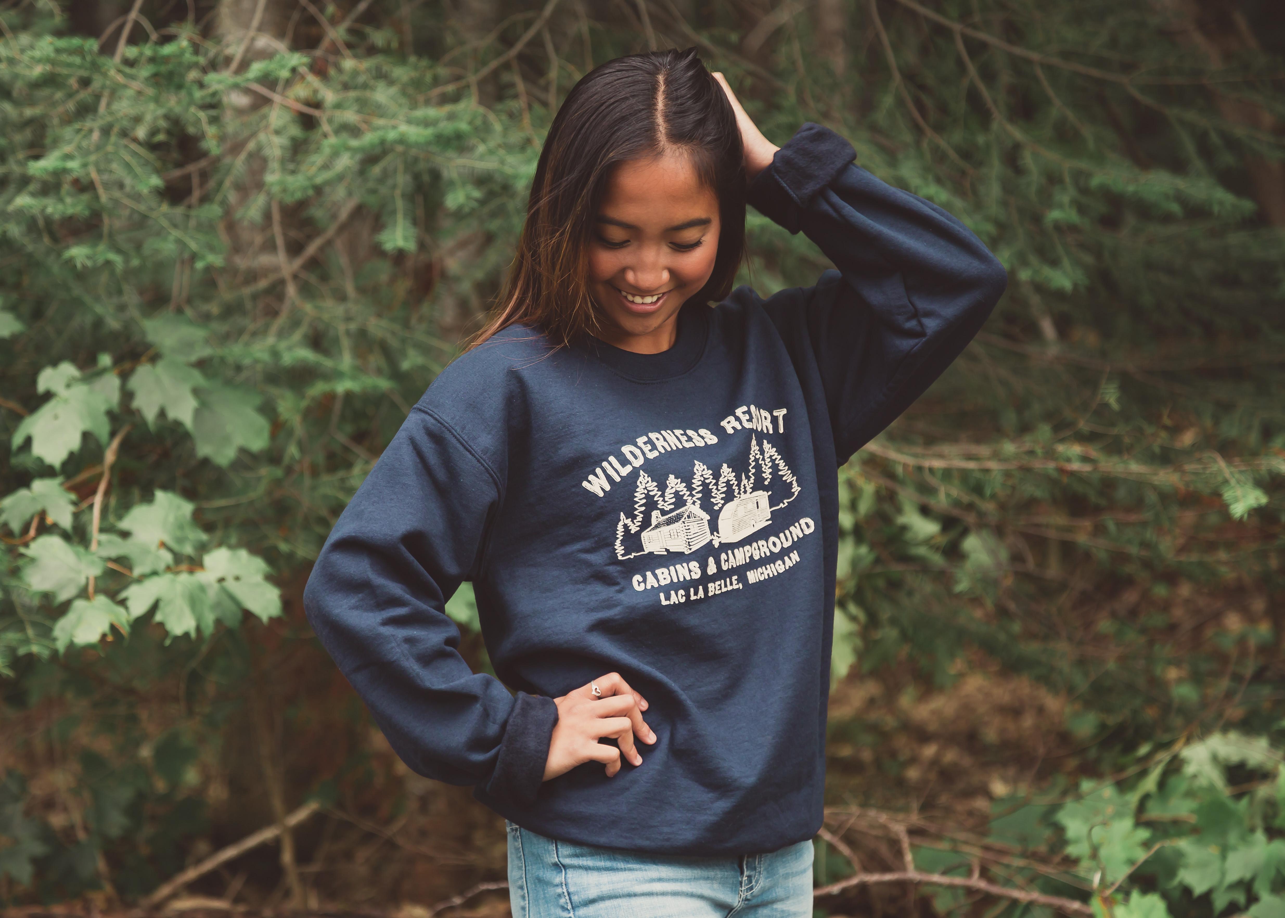 Wilderness Resort LLC Apparel Navy Blue Crewneck Sweatshirt on Model Paulyne