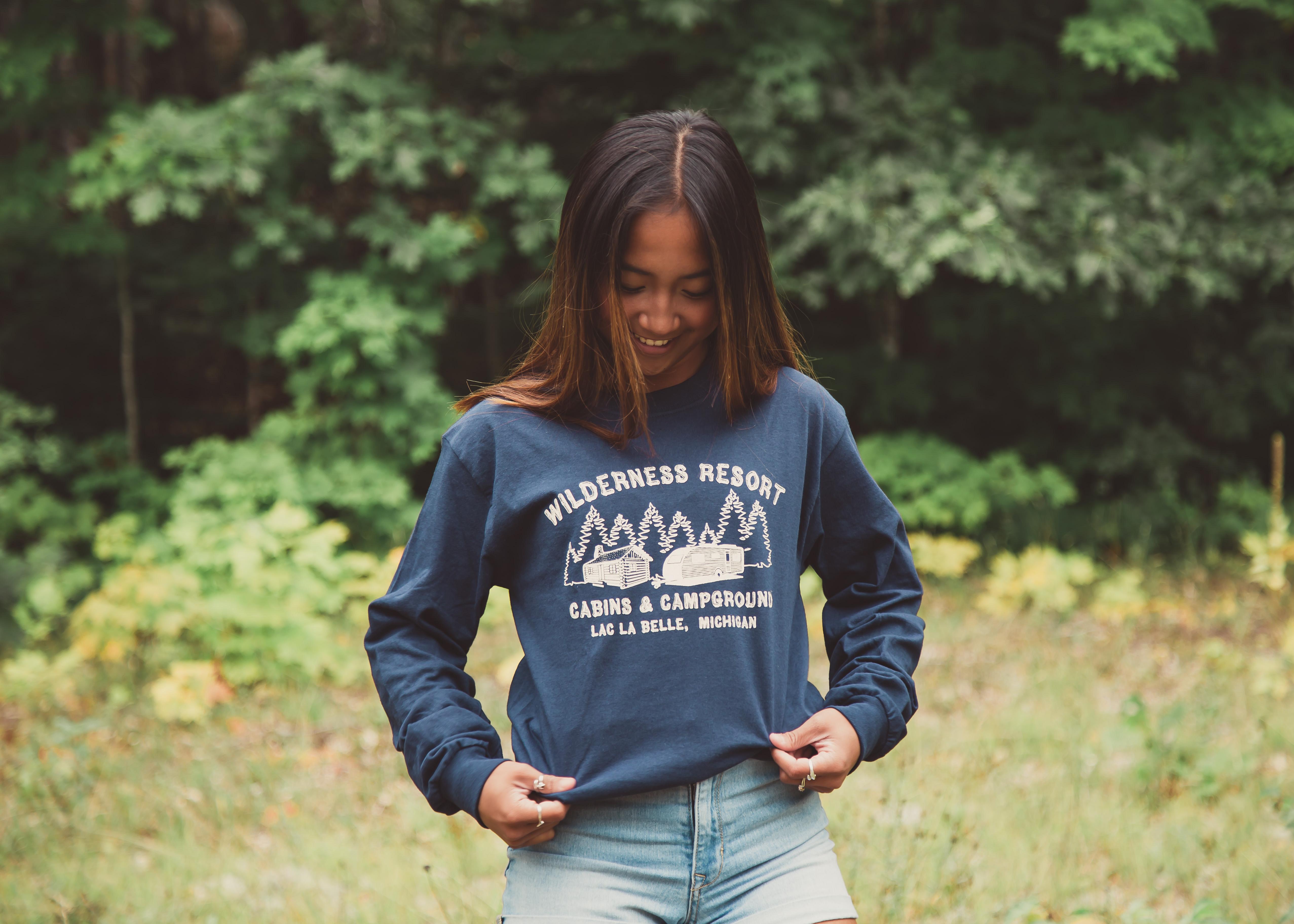 Wilderness Resort LLC Apparel Navy Blue Long Sleeve T-Shirt on Model Paulyne