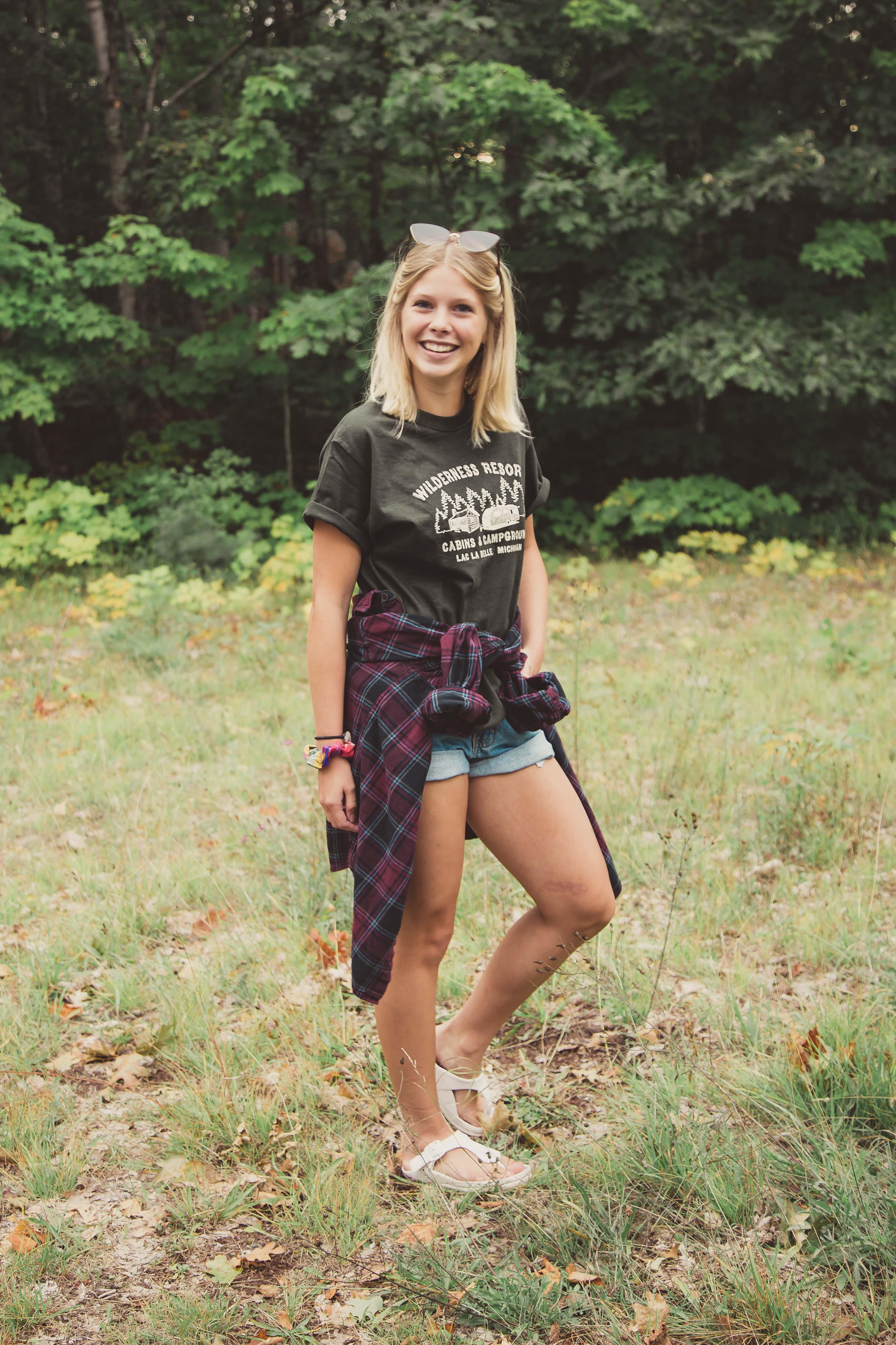 Wilderness Resort LLC Apparel Hunter Green Short Sleeve T-Shirt on Model Maddy