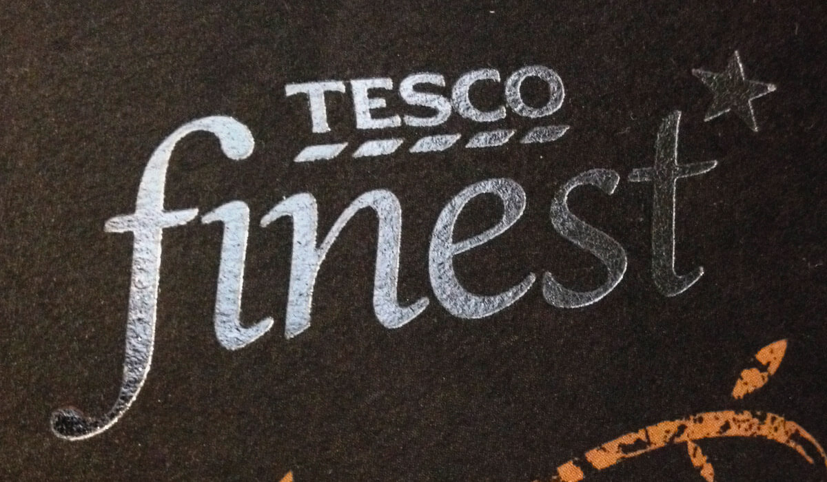This is the Tesco Finest* logo, in silver foil on a black background. The range is the largest premium own-label retail range in the UK. Pemberton & Whitefoord LLP has been working on Tecso Finest packaging design solutions since 1998.
