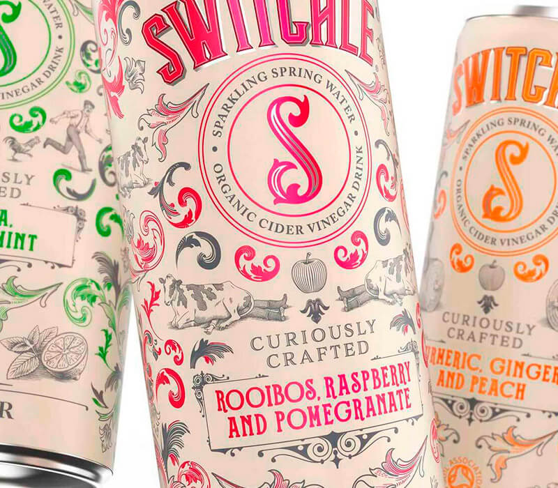 Three Switchle cans on a white background. Switchle can packaging design by Pemberton & Whitefoord LLP for Healthy Food Brands. The product is a soft-drink for adults.
