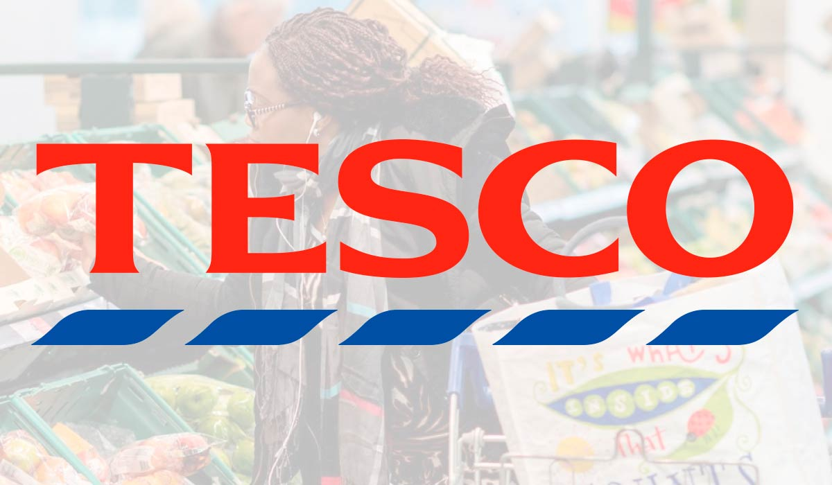 This is Tesco's logo on top of an image of a lady shopping in the fruit and vegetable aisle. Pemberton & Whitefoord LLP has been working with Tesco for 30 years on packaging design, retail design and more.