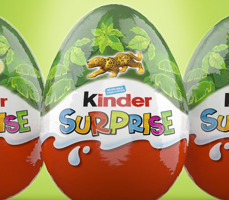 This image features three Kinder Surprise eggs that were designed by Pemberton & Whitefoord LLP. The designs feature the toys contained inside and the outer wrapper includes the Kinder Surprise logo.