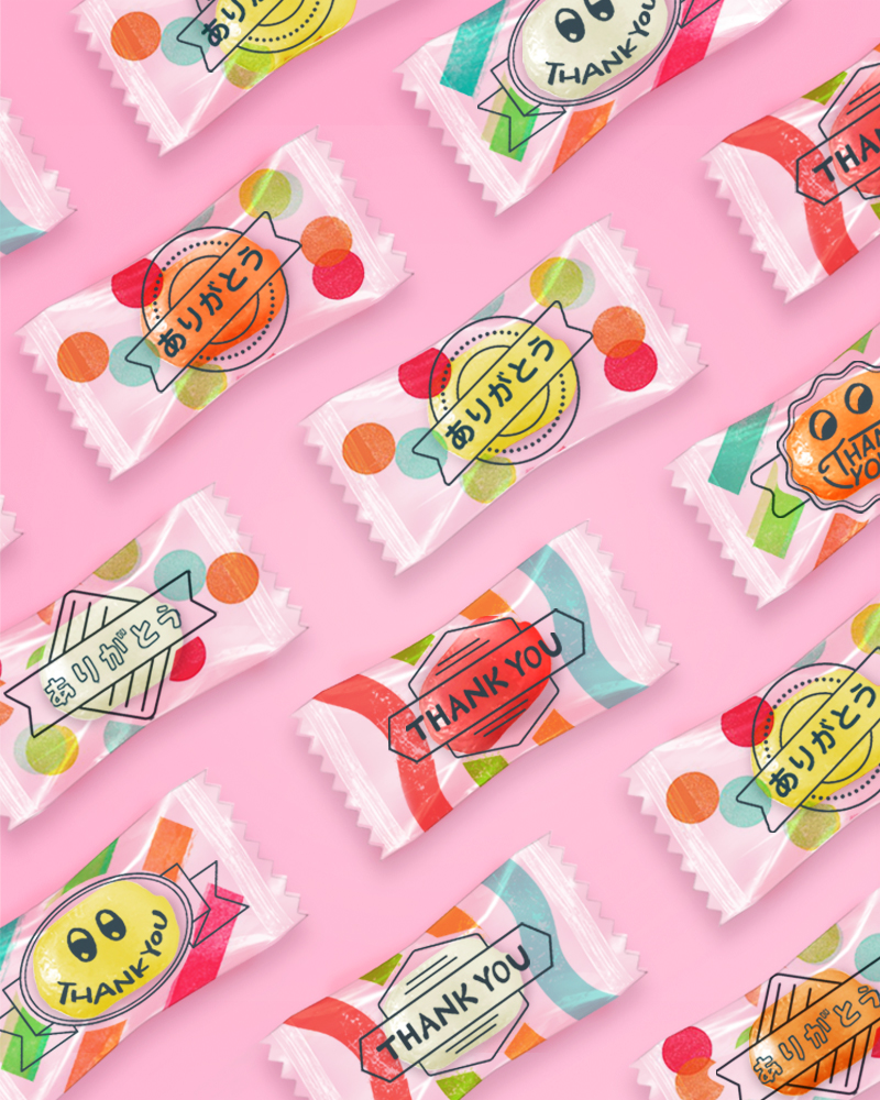 A cute and colourful retail packaging design solution for Askul by Pemberton & Whitefoord LLP featuring little faces and colourful swirls of pink, orange and blue.