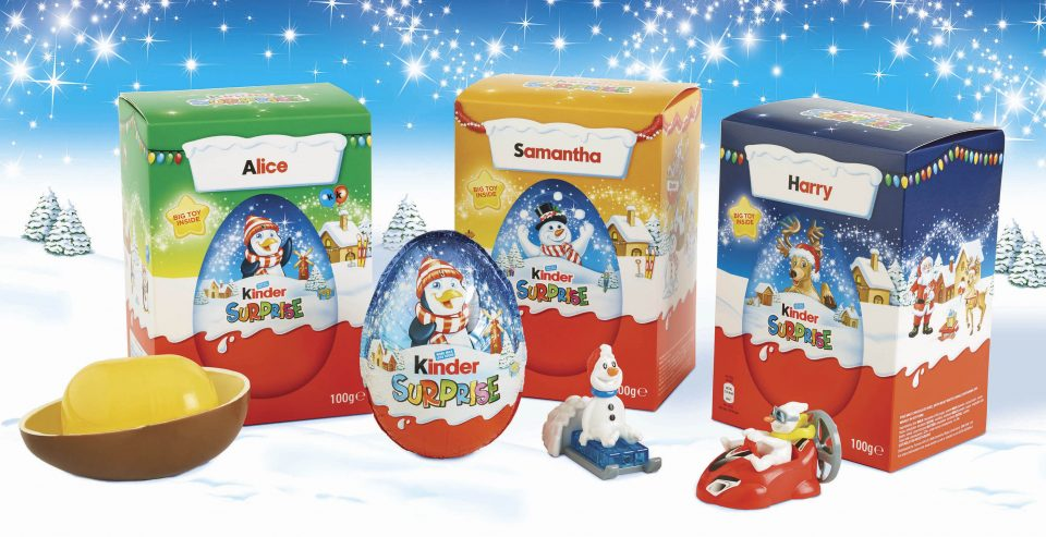 This image is of three Kinder Surprise egg boxes on a white, snowy background. The packaging design solution was produced by Pemberton & Whitefoord LLP