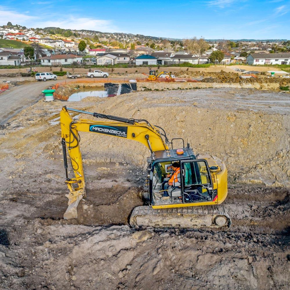 Papakura - Digger at Clevedon road development, civil works.