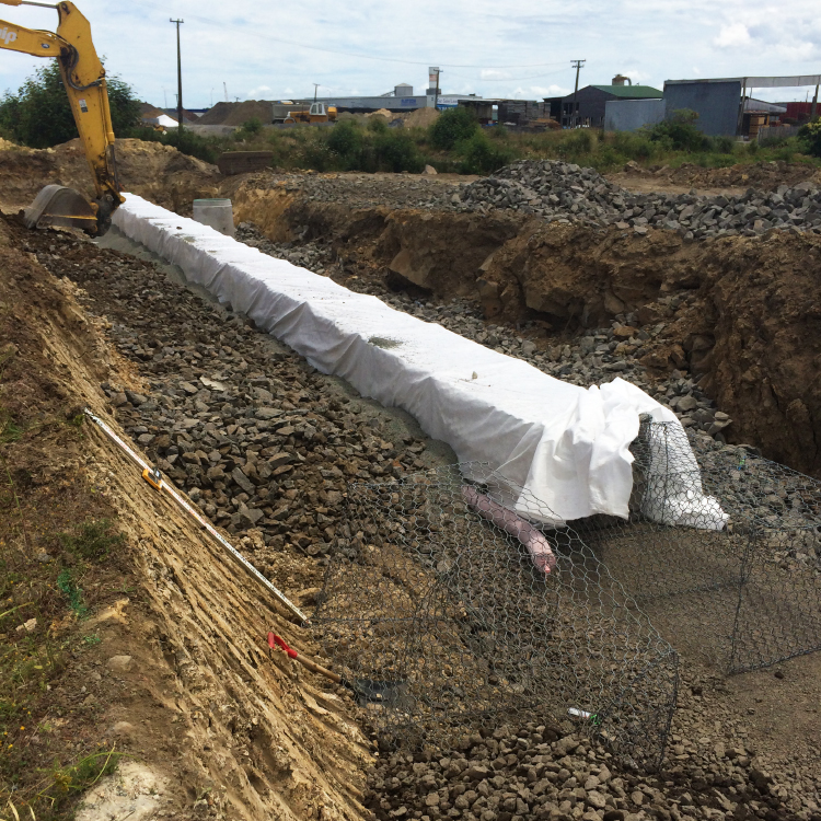 Digging trenches for pipe laying at 3 Kings