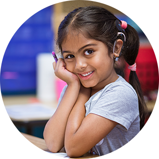 Young girl with hearing aids