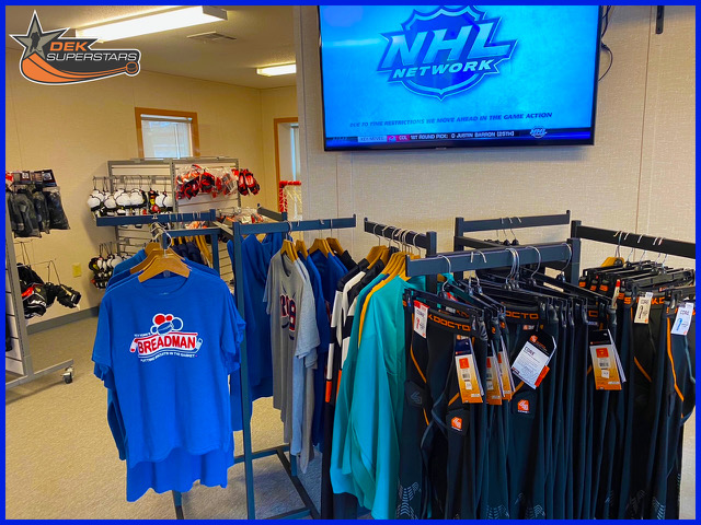 A picture of merchandise in a hockey shop.