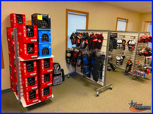 A picture of hockey gear in a shop.