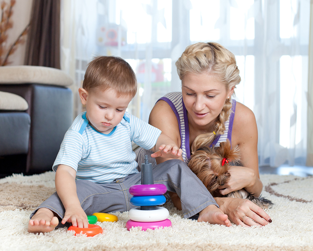 mother and son playing on fresh clean carpets