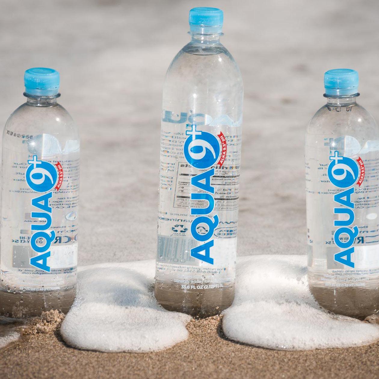 AQUA 9+ Bottles Near Ocean