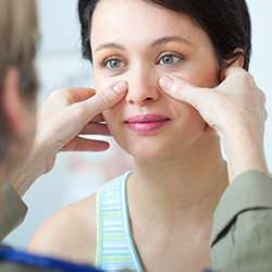 Woman receives consultation for rhinoplasty