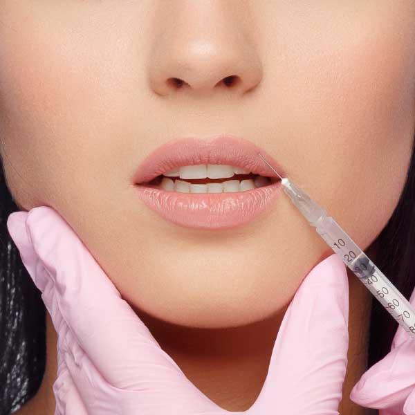 Woman receiving filler treatment