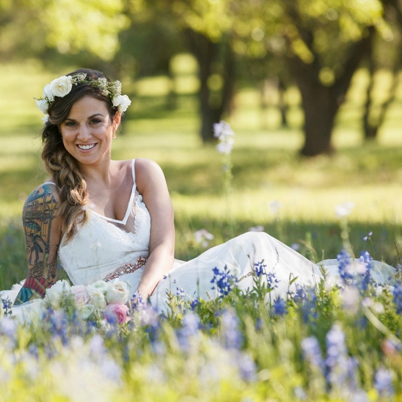 The bride in a field of bluebonnets.