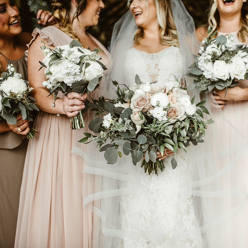 The bride, bridesmaids and their wedding floral.