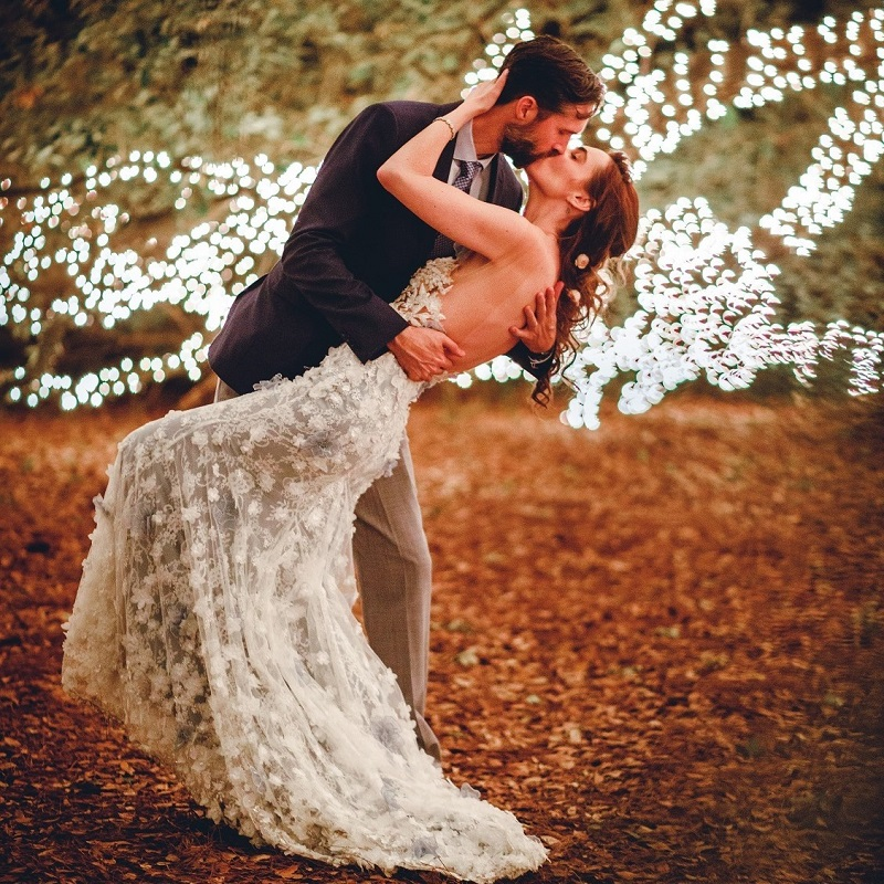 The couple kissing on their wedding day.