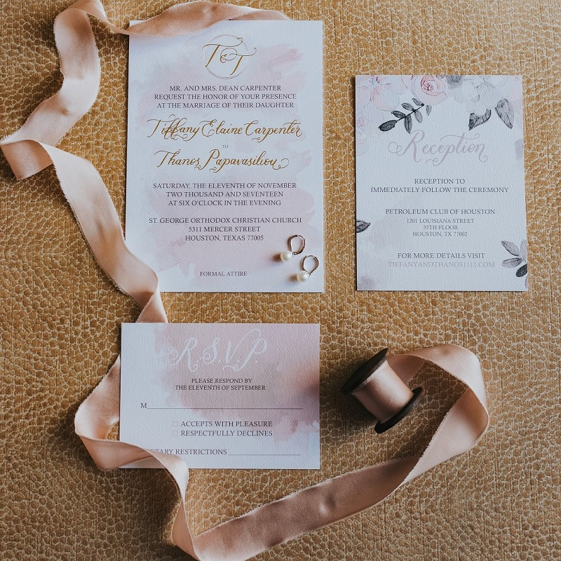 The bride and grooms custom wedding invitation.