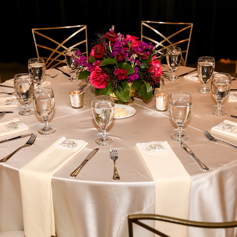 Wedding reception table with the floral centerpiece.