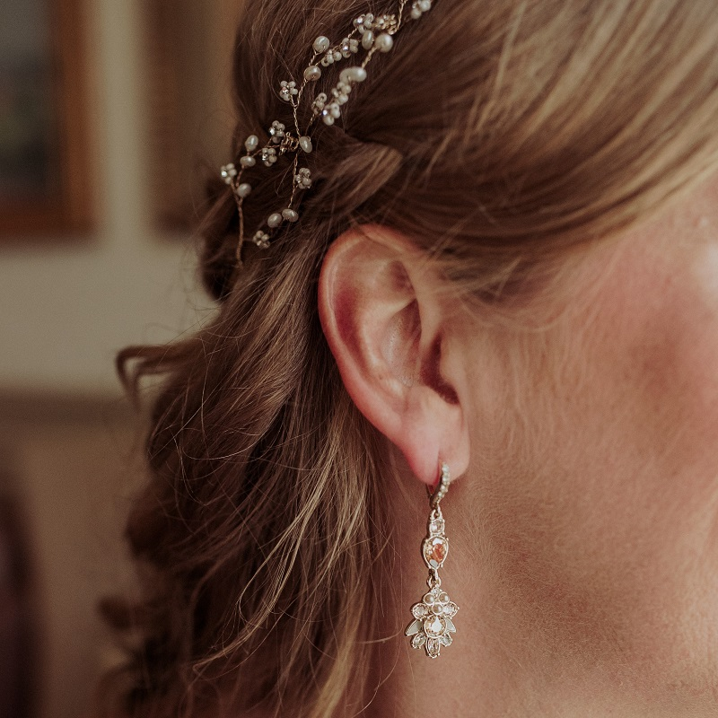 Detail shot of the brides jewelry and hair.