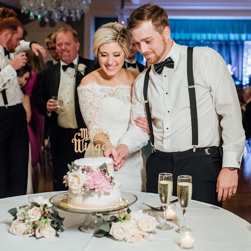 The bride and groom cutting their wedding cake.
