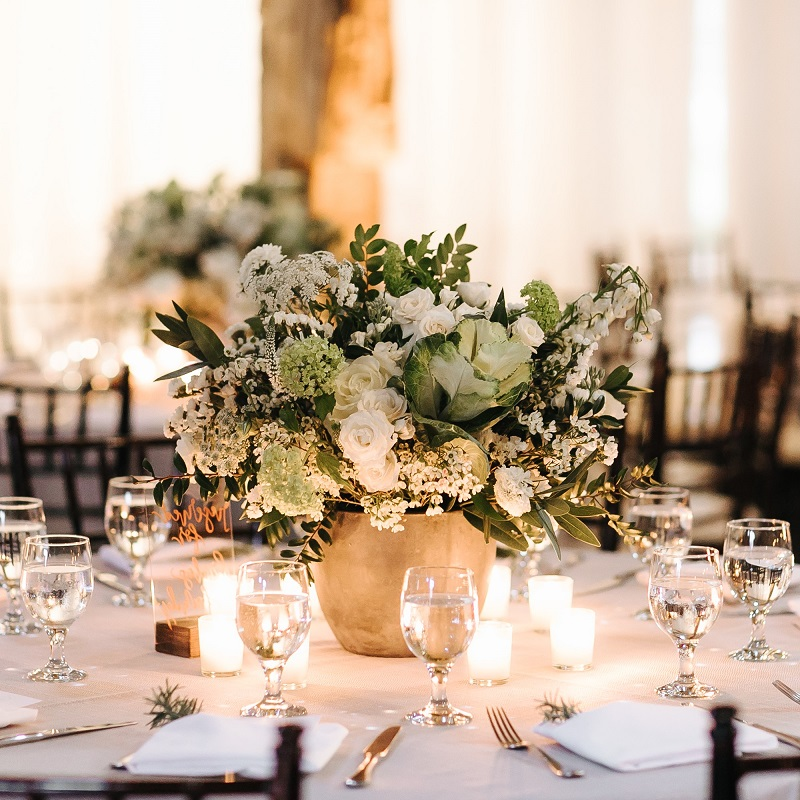 White and ivory floral with greenery wedding centerpiece.