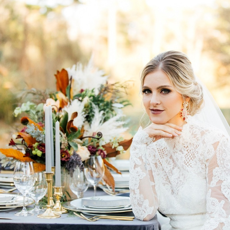 The model bride sitting at the reception table.