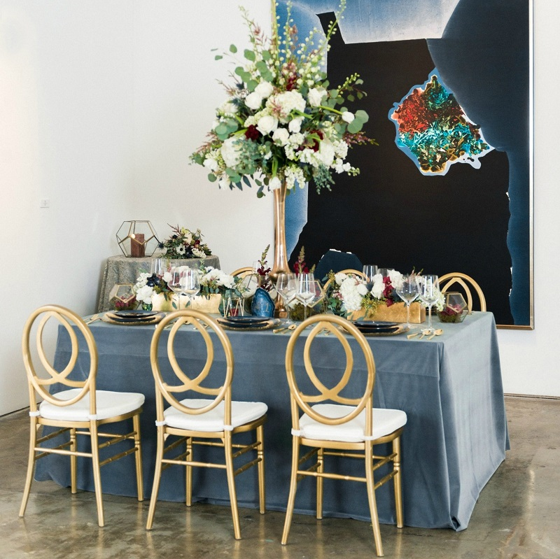 Velvet tablscape with floral centerpieces and inspirational art.