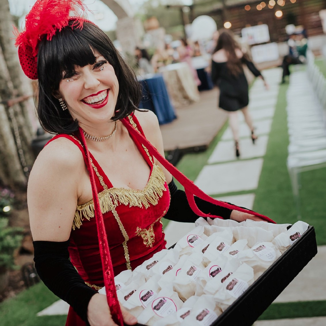 Cigarette girl handing out sweet carvial treats.