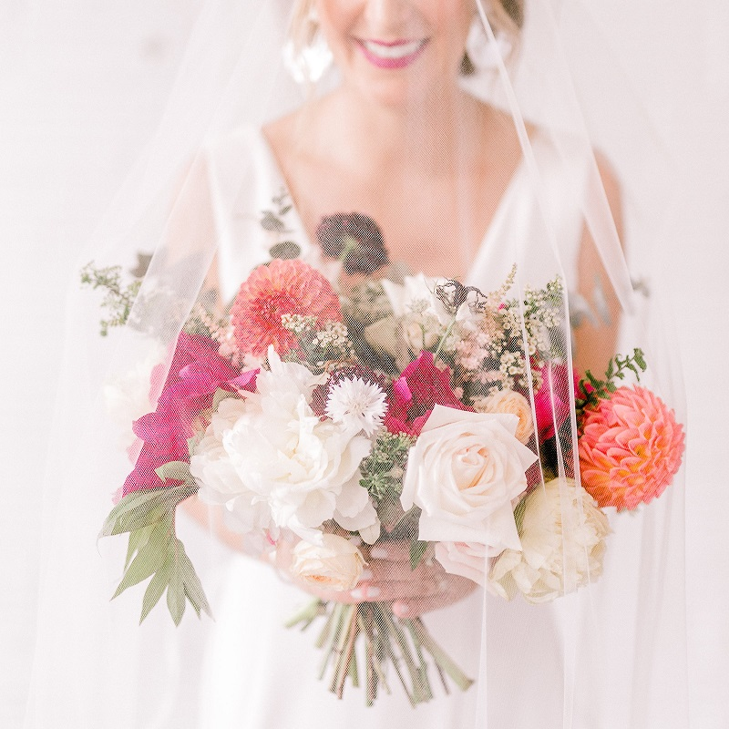 Gorgeous shot of the wedding veil and bridal bouquet.