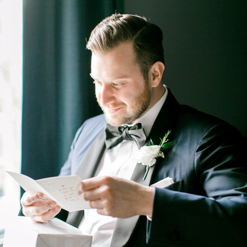Letter Reading by Groom