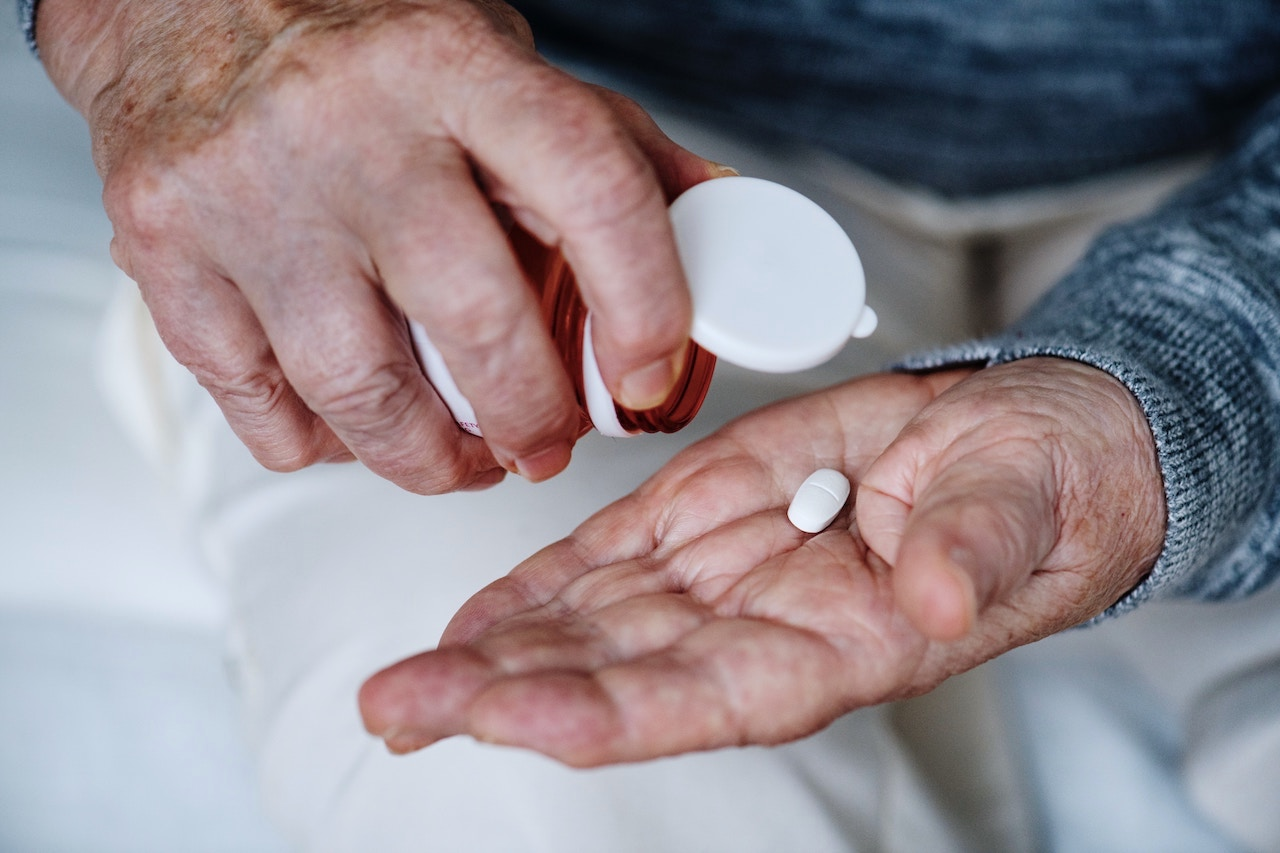 man taking prescription pill