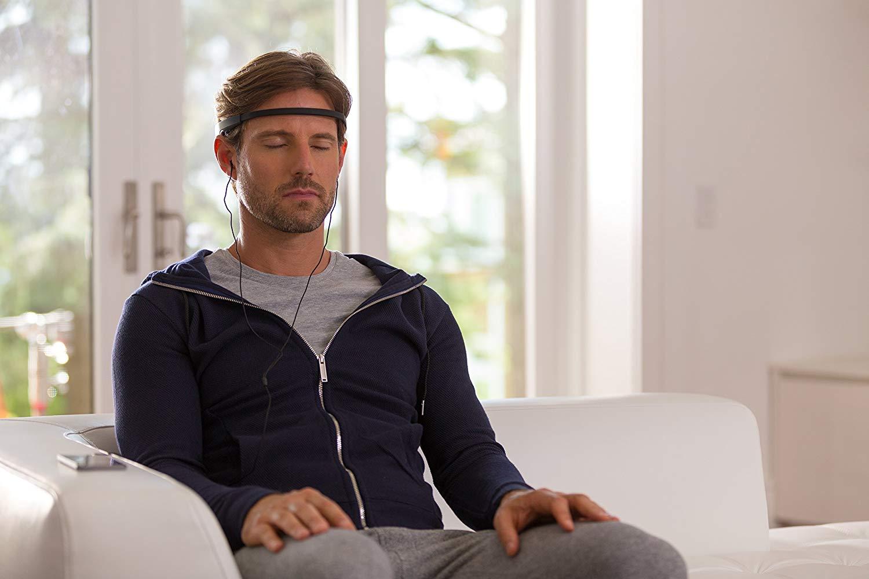 man wearing MUSE brain sensing headband