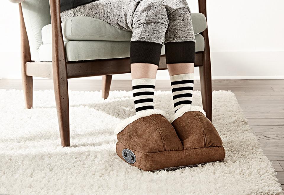 girl wearing vibrating slipper massagers