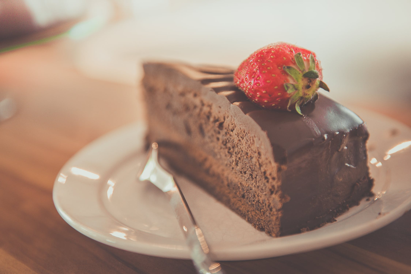 Chocolate cake slice with strawberry on top