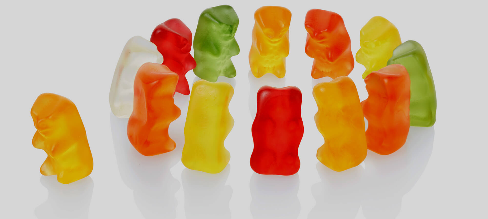 A group of gummy bears excluding one of their kind