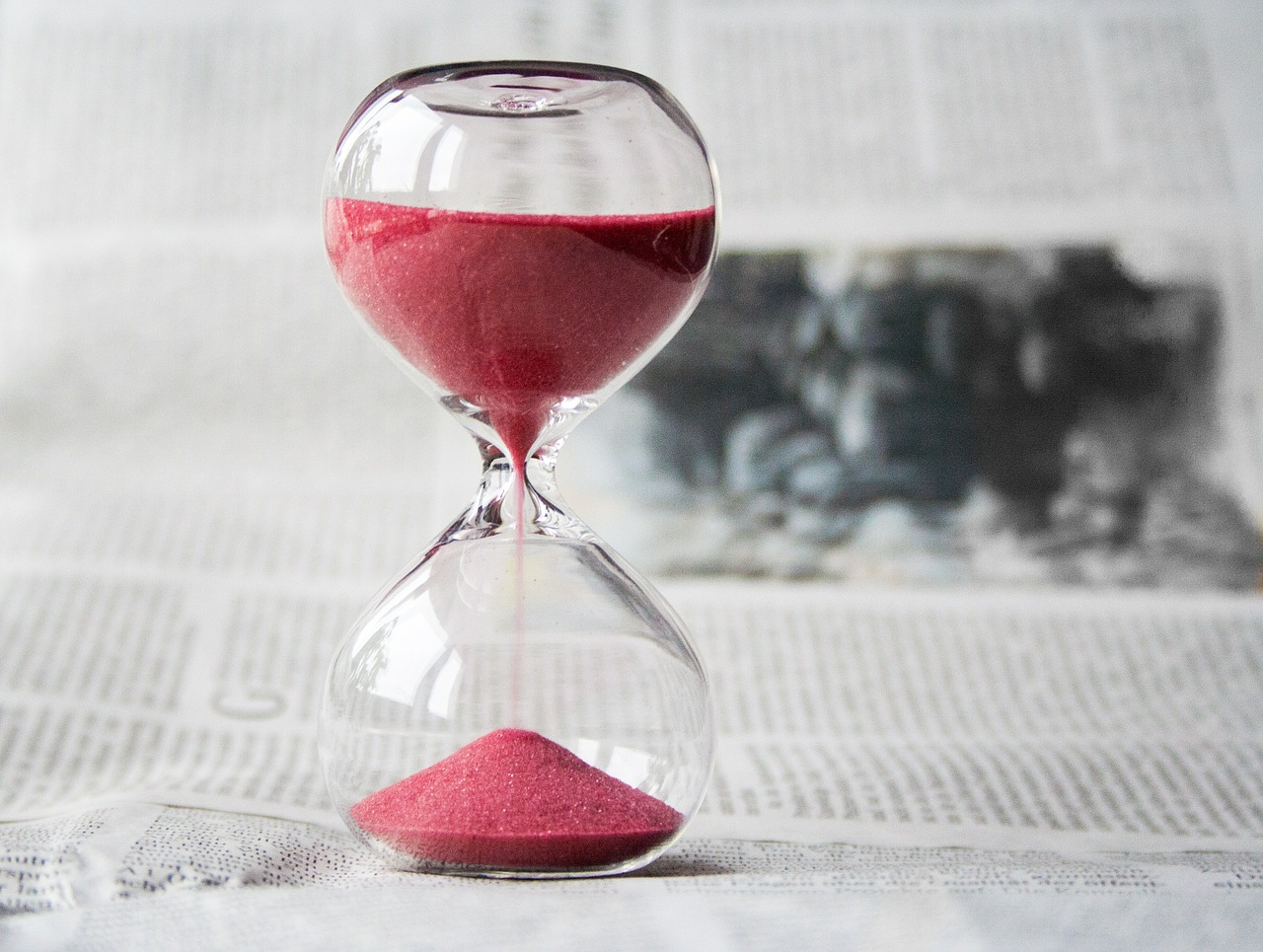 an hourglass with red sand