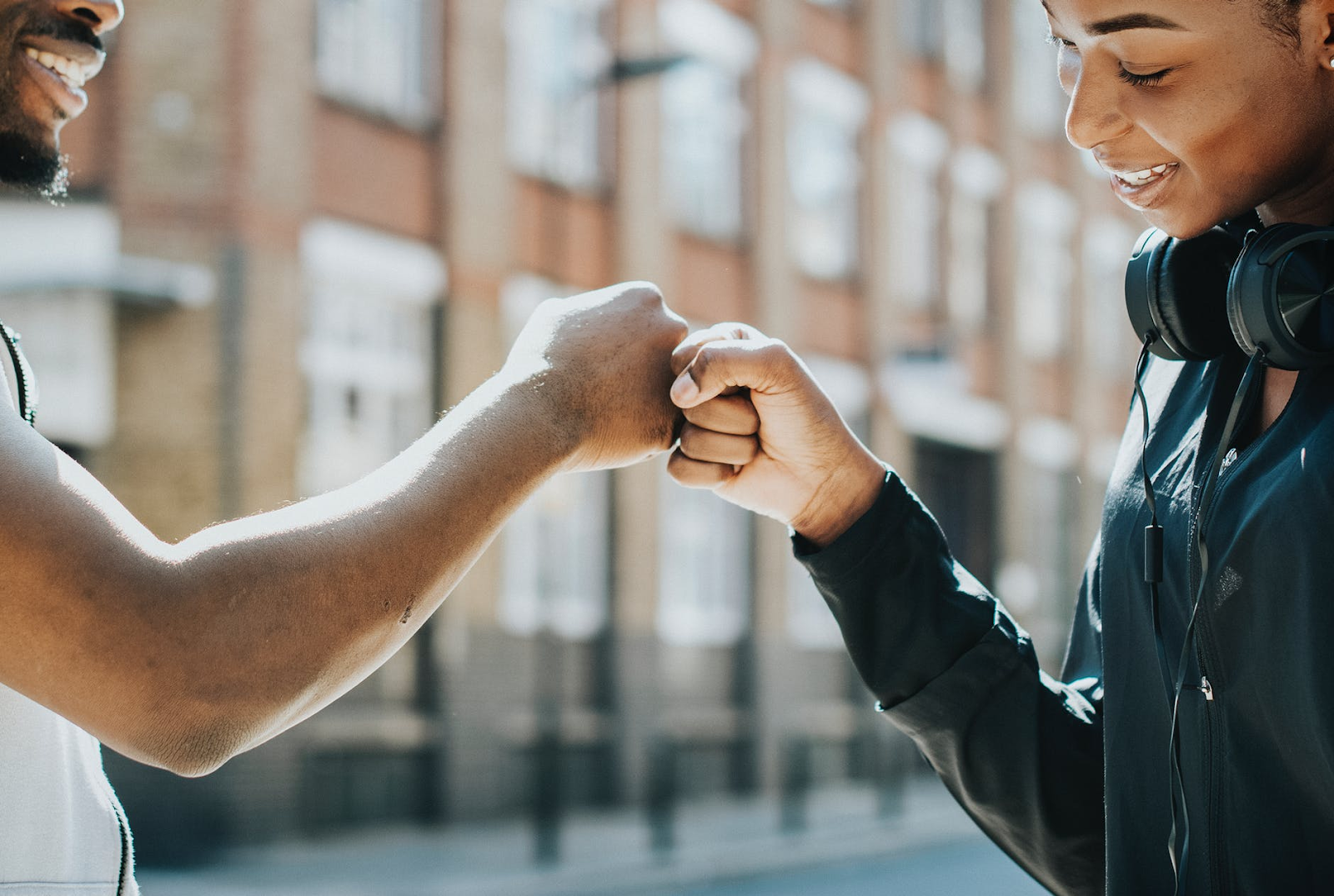 fist bump between a woman and a man