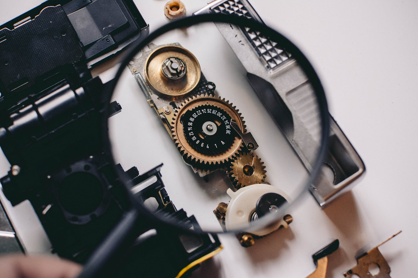 gears under a magnifying glass