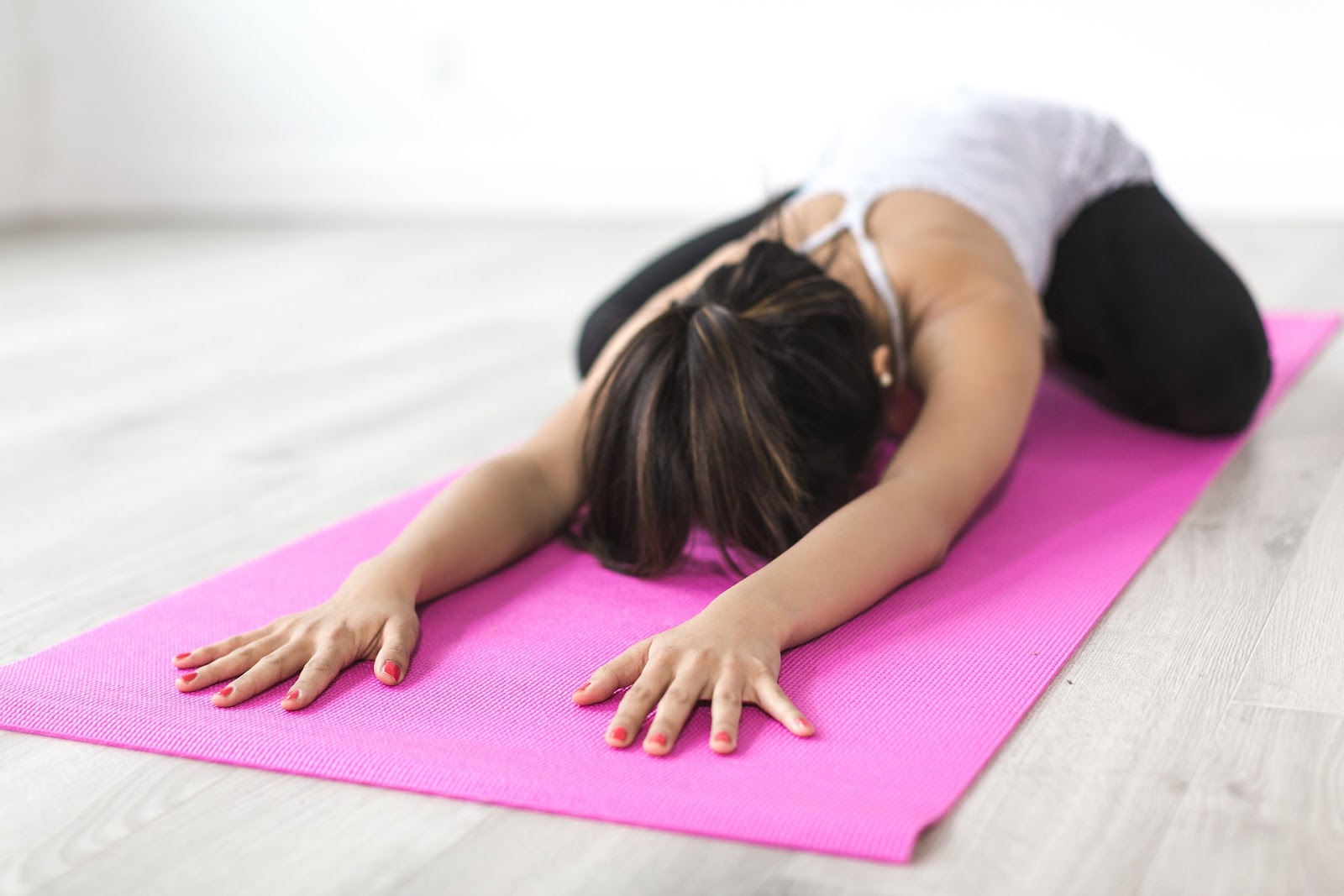 woman doing a relaxing yoga pose