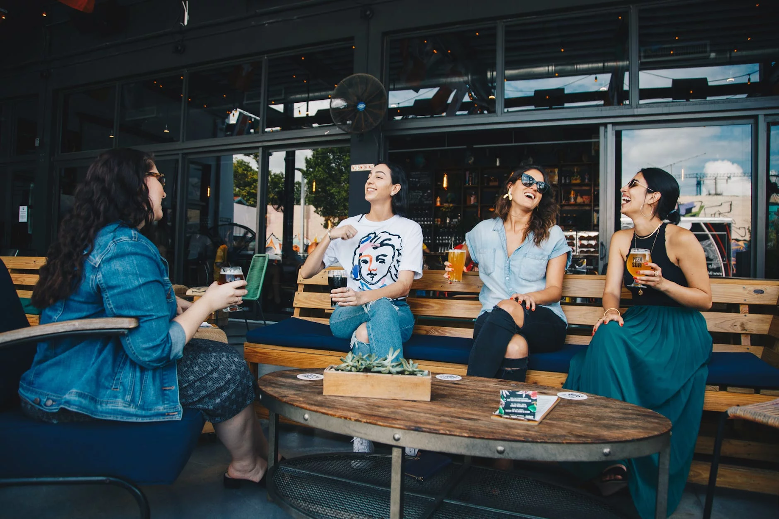 Four Women Laughing and Having a Drink