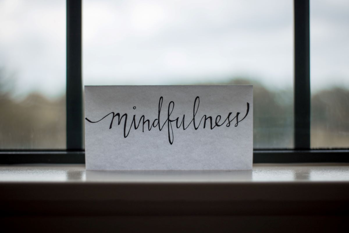 A Note Reading Mindfulness in Front of a Window