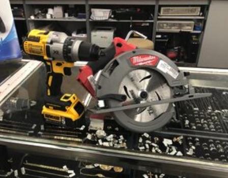 DeWalt drill and Milwaukee skillsaw on display at Sportsman's Pawn Shop.
