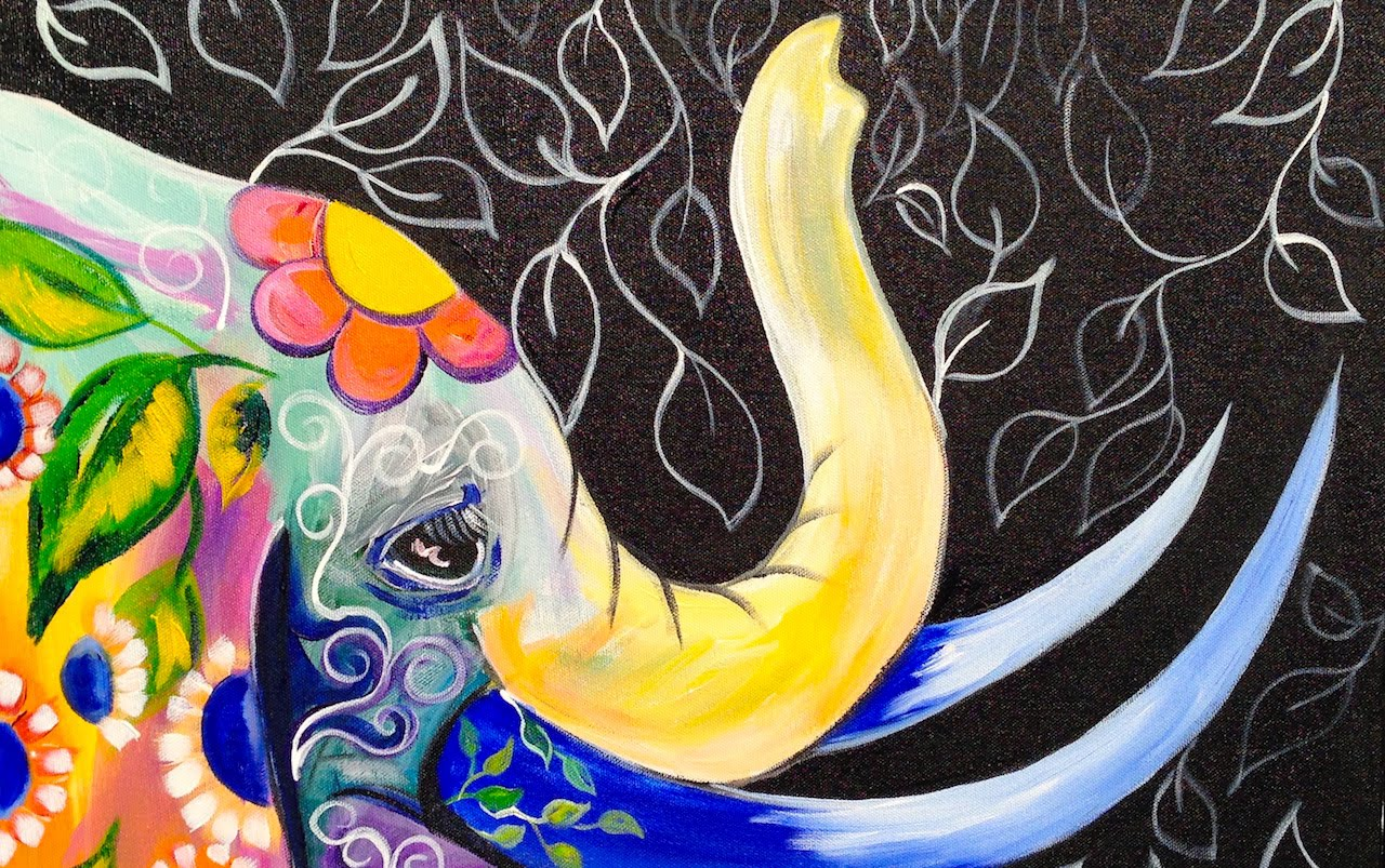painting of an elephant that has Hindu symbols of flowers and peacock feathers with a black whimsical background