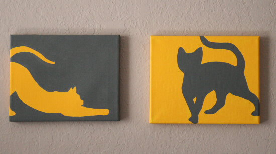 2 mini paintings of grey and yellow cats