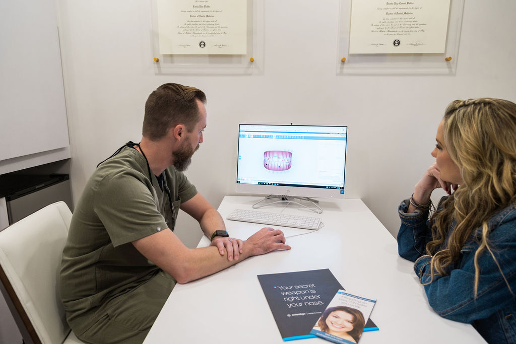 Dr. Dustin Dodds discussing Invisalign with a patient