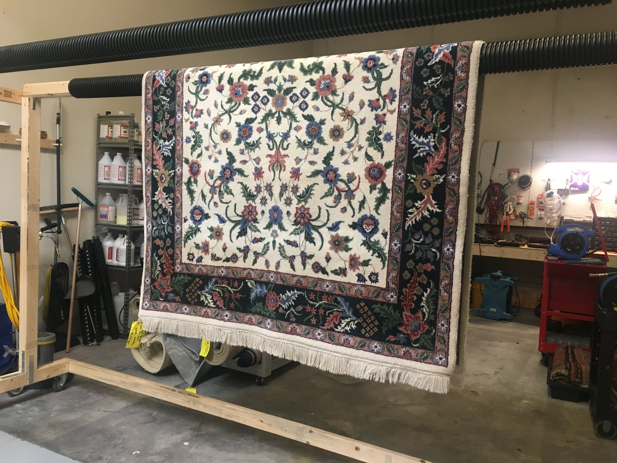 oriental rug hanging to dry